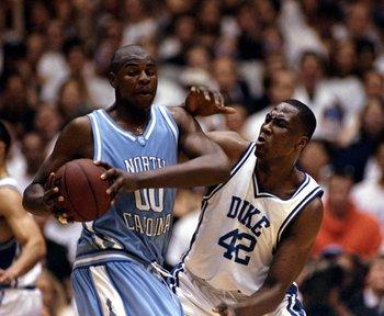 27 Jan 1999: Elton Brand #42 of the Duke Blue Devils tries to guard Brendan Haywood #00 of the North Carolina Tar Heels at the Cameron Indoor Stadium in Durham, North Carolina. The Blue Devils defeated the Tar Heels 89-77.