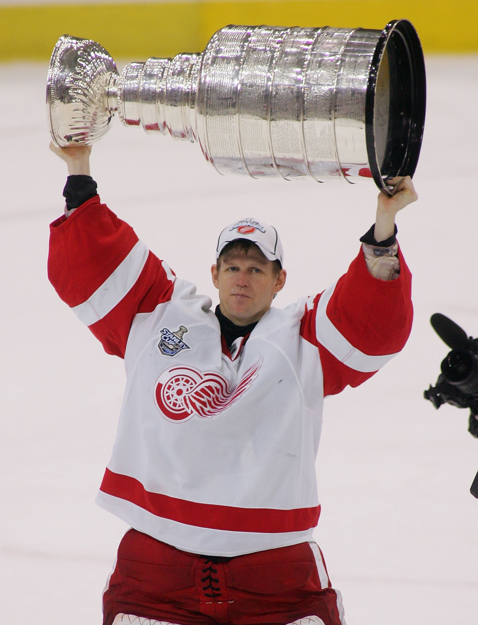 PITTSBURGH - JUNE 04:  Chris Osgood #30 of the Detroit Red Wings celebrates with the Stanley Cup after defeating the Pittsburgh Penguins in game six of the 2008 NHL Stanley Cup Finals at Mellon Arena on June 4, 2008 in Pittsburgh. Pennsylvania. The Red Wi