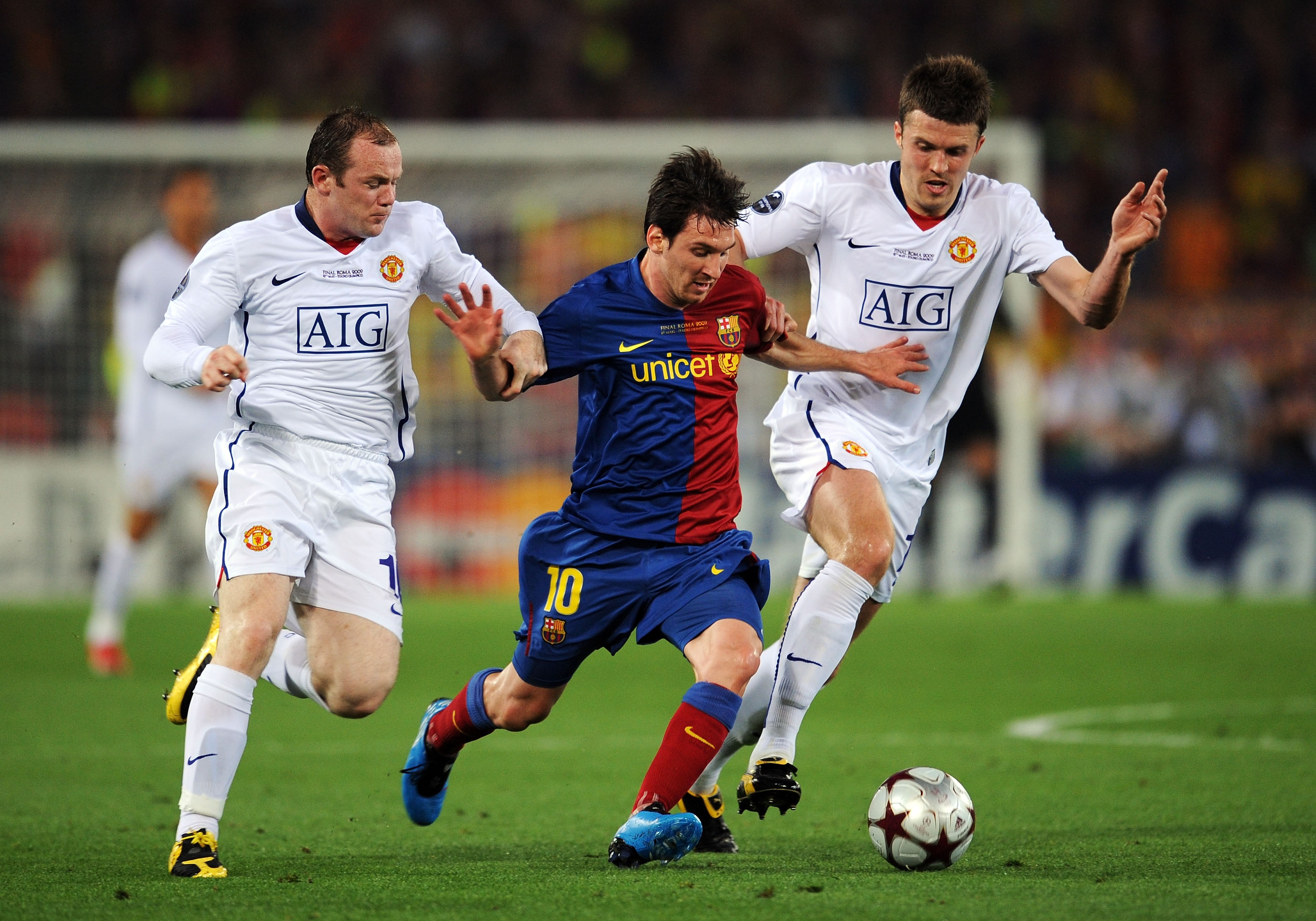 ROME - MAY 27:  Lionel Messi of Barcelona battles for the ball with Wayne Rooney of Manchester United and Michael Carrick of Manchester United during the UEFA Champions League Final match between Barcelona and Manchester United at the Stadio Olimpico on M