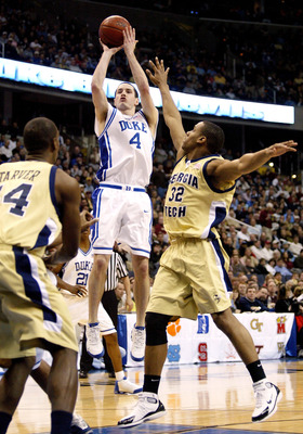 WASHINGTON - MARCH 13:  J.J. Redick #4 of the Duke Blue Devils puts up a jump shot over Jeremis Smith #32 of the Georgia Tech Yellow Jackets during the ACC Tournament Championship Game against the Georgia Tech Yellow Jackets on March 13, 2005 at the MCI C
