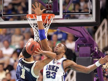 GREENSBORO, NC - MARCH 18:  Shelden Williams #23 of the Duke Blue Devils tries to block Omar Williams #1 of the George Washington Colonials during the Second Round of the 2006 NCAA Men's Basketball Tournament on March 18, 2006 at the Greensboro Coliseum i