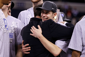 INDIANAPOLIS - APRIL 05:  Head coach Mike Krzyzewski and Jon Scheyer (R) of the Duke Blue Devils celebrate after they won 61-59 against the Butler Bulldogs during the 2010 NCAA Division I Men's Basketball National Championship game at Lucas Oil Stadium on