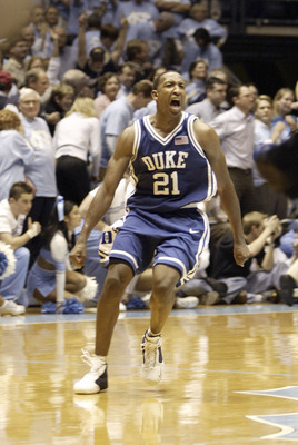 CHAPEL HILL, NC - FEBRUARY 5: Chris Duhon #21 of the Duke Blue Devils celebrates after beating the University of North Carolina Tar Heels with his final shot on February 5, 2004 at the Dean E. Smith Center in Chapel Hill, North Carolina.  (Photo by Street