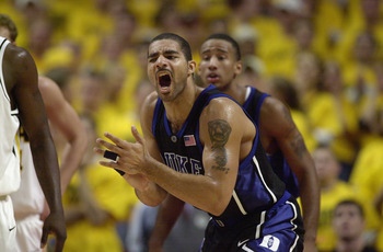 CHICAGO - NOVEMBER 27: Carlos Boozer #4 of the Duke Blue Devils celebrates during the ACC/Big Ten Challenge against the Iowa Hawkeyes at United Center in Chicago, Illinois on November 27, 2001. The Blue Devils won 80-62.   (Photo by Jonathan Daniel/Getty