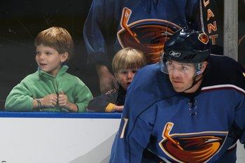 ATLANTA, GA - SEPTEMBER 29:  Young fans watch warm-ups behind J. P. Vigier #11 of the Atlanta Thrashers before the game against the Nashville Predators on September 29, 2006 at Philips Arena in Atlanta, Georgia. (Photo by Scott Cunningham/Getty Images)