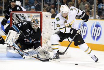 SAN JOSE, CA - MARCH 31: Antti Niemi #31 of  the San Jose Sharks defends his goal against Jamie Langenbrunner #15 of the Dallas Stars in the third period during an NHL hockey game at the HP Pavilion on March 31, 2011 in San Jose, California. The Sharks wo