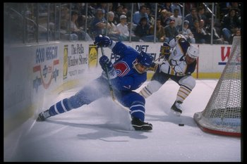 28 Mar 1995:  Defenseman Curtis Leschyshyn of the Quebec Nordiques (left) goes for the puck during a game against the Buffalo Sabres at Memorial Auditorium in Buffalo, New York.  The Sabres won the game, 5-3. Mandatory Credit: Rick Stewart  /Allsport