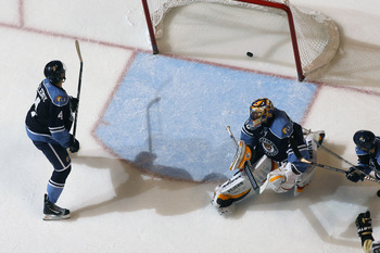 SUNRISE, FL - APRIL 2: Keaton Ellerby #4 of the Florida Panthers watches as the puck shot by Zbynek Michalek #4 (not pictured) of the Pittsburgh Penguins scores the winning goal past goaltender Scott Clemmensen #30 on April 2, 2011 at the BankAtlantic Cen