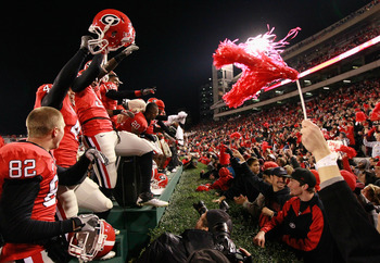 ATHENS, GA - NOVEMBER 27:  The Georgia Bulldogs celebrate their 42-34 win over the Georgia Tech Yellow Jackets at Sanford Stadium on November 27, 2010 in Athens, Georgia.  (Photo by Kevin C. Cox/Getty Images)
