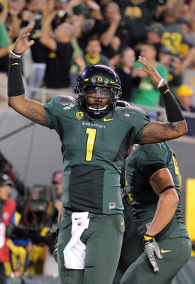 EUGENE, OR - OCTOBER 2: Quarterback Darron Thomas #1 of the Oregon Ducks celebrates after scoring a touchdown in the third quarter of the game against the Stanford Cardinal at Autzen Stadium on October 2, 2010 in Eugene, Oregon. Oregon won the game 52-31.