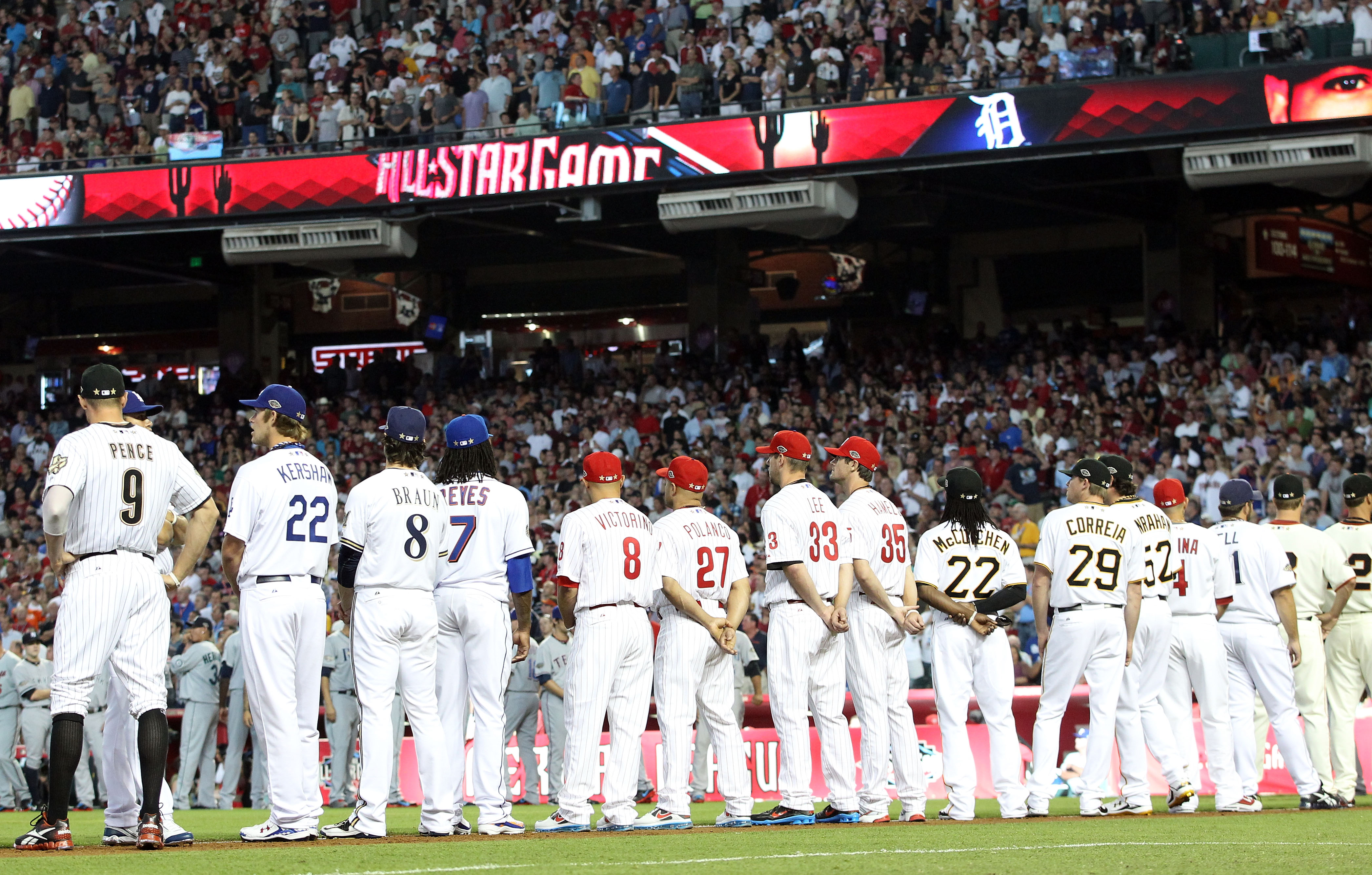 PHOENIX, AZ - JULY 12:  The National League All-Stars stand on the third base line before the start of the 82nd MLB All-Star Game at Chase Field on July 12, 2011 in Phoenix, Arizona.  (Photo by Christian Petersen/Getty Images)