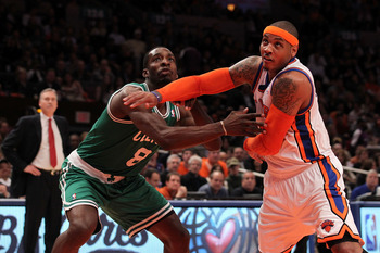 NEW YORK, NY - APRIL 22:  Carmelo Anthony #7 of the New York Knicks fights for rebound position against Jeff Green #8 of the Boston Celtics as Knicks head coach Mike D'Antoni (L) in the first half of Game Three of the Eastern Conference Quarterfinals in t