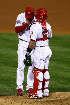 PHILADELPHIA - NOVEMBER 01:  (L-R) Brad Lidge #54 and Carlos Ruiz #51 of the Philadelphia Phillies talk on the mound in the top of the ninth inning against the New York Yankees in Game Four of the 2009 MLB World Series at Citizens Bank Park on November 1,