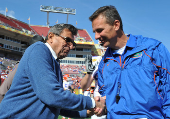 TAMPA, FL - JANUARY 1:  Coach Joe Paterno of the Penn State Nittany Lions greets coach Urban Meyer of the Florida Gators before play in the 25th Outback Bowl at Raymond James Stadium January 1, 2011 in Tampa, Florida.  (Photo by Al Messerschmidt/Getty Ima