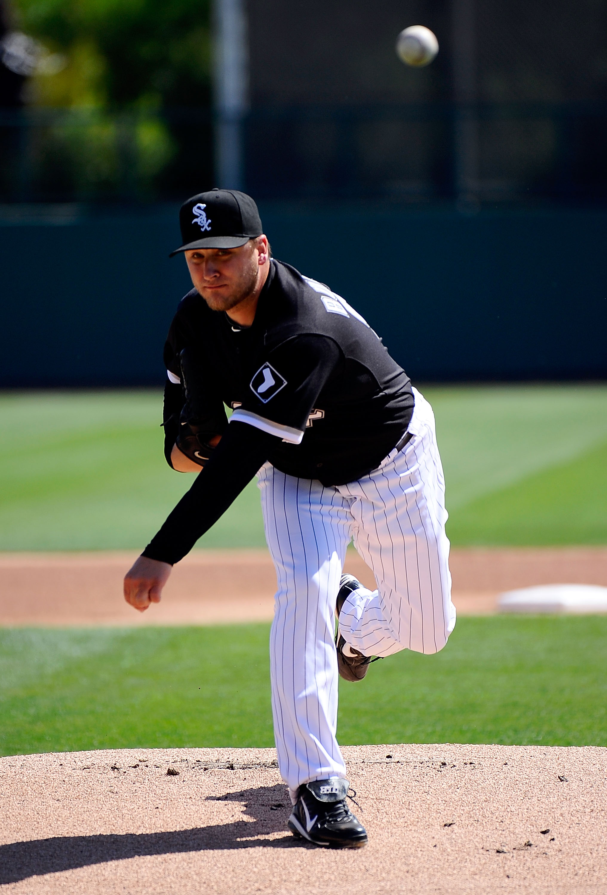 GLENDALE, AZ - MARCH 11:  Mark Buehrle #56 of the Chicago White Sox pitches during the spring training baseball game against Chicago Cubs at Camelback Ranch on March 11, 2011 in Glendale, Arizona.  (Photo by Kevork Djansezian/Getty Images)