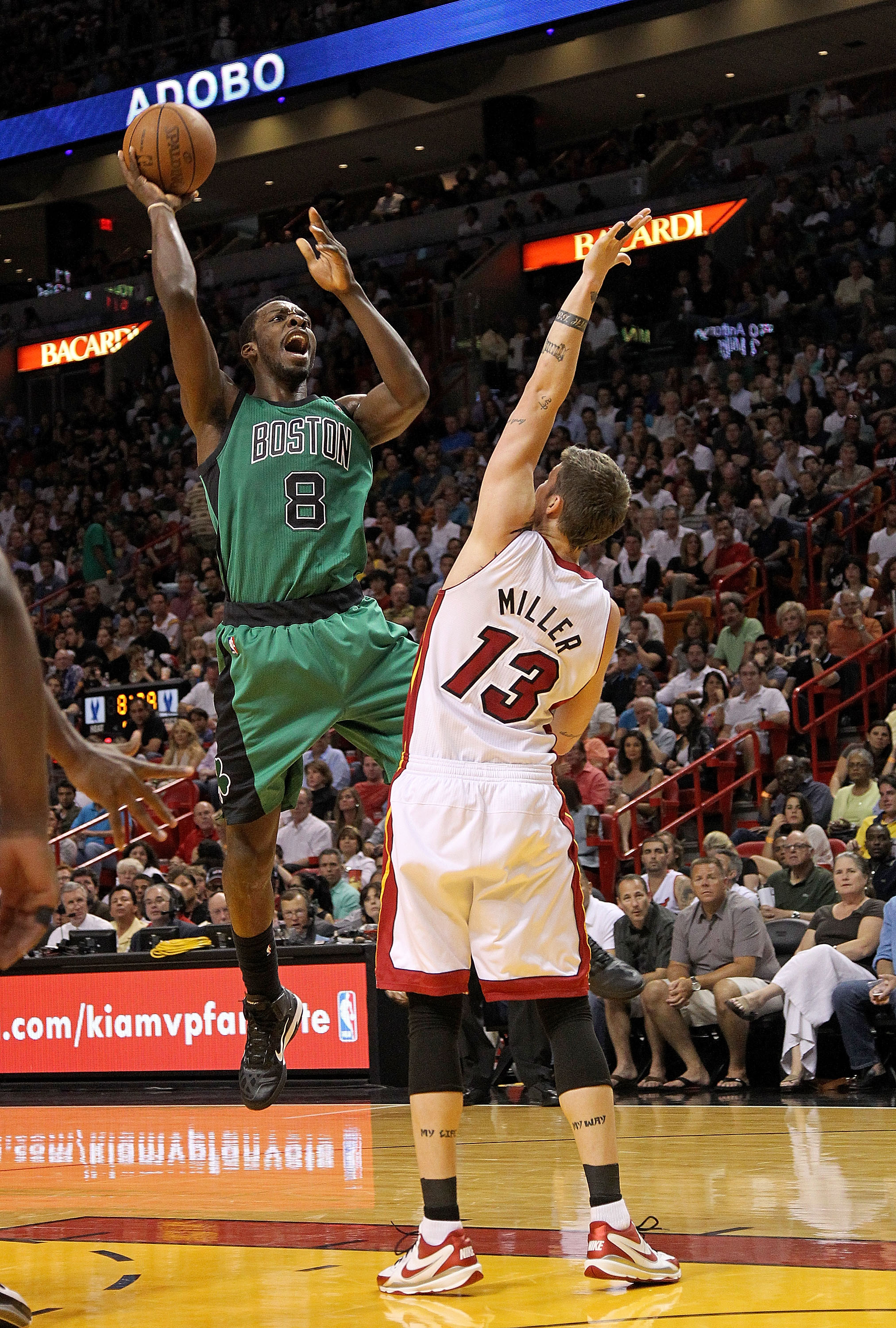 MIAMI, FL - APRIL 10:  Jeff Green #8 of the Boston Celtics shoots over Mike Miller #13 of the Miami Heat during a game at American Airlines Arena on April 10, 2011 in Miami, Florida. NOTE TO USER: User expressly acknowledges and agrees that, by downloadin