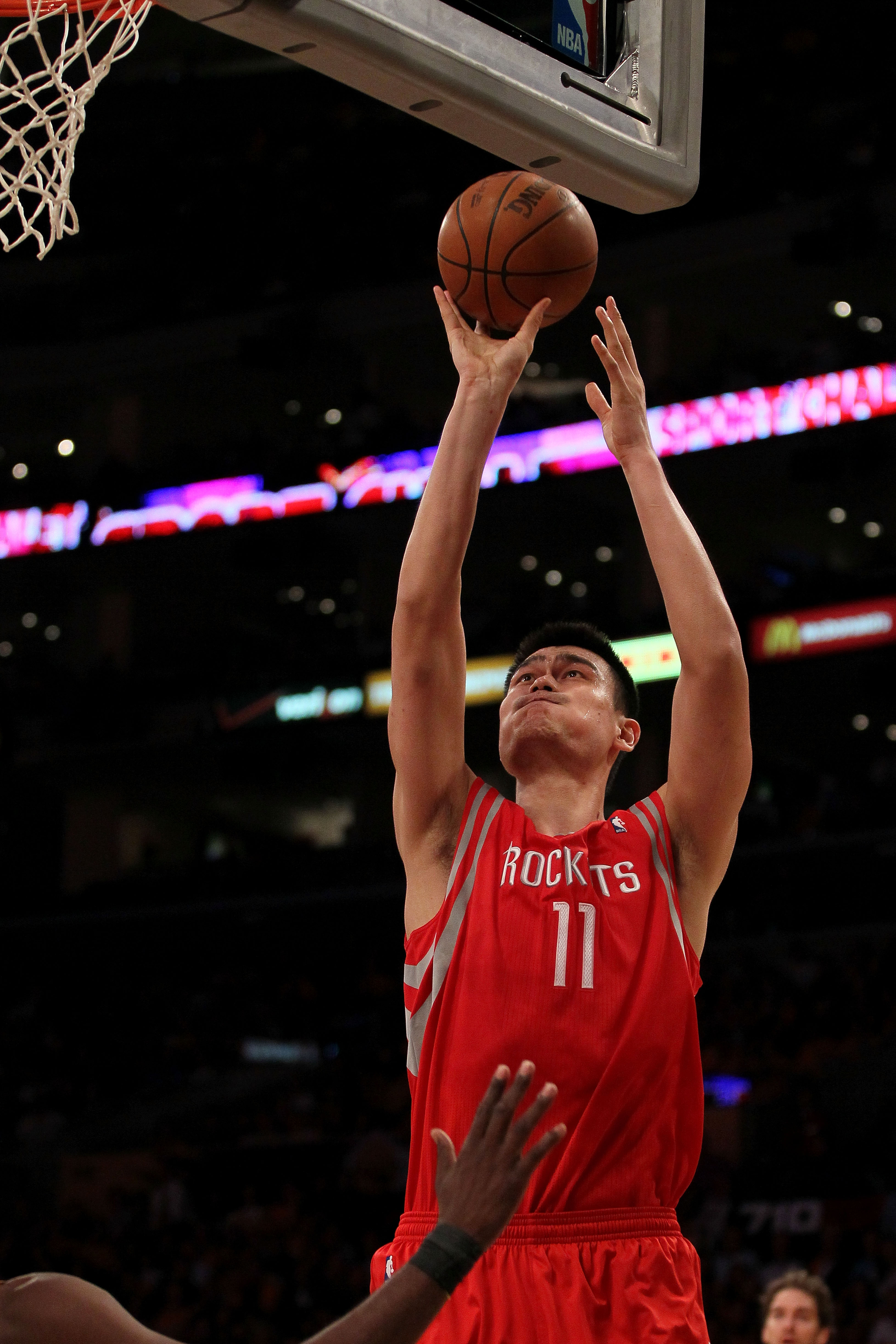 LOS ANGELES, CA - OCTOBER 26:  Yao Ming #11 of the Houston Rockets takes a shot against the Los Angeles Lakers during their game at Staples Center on October 26, 2010 in Los Angeles, California. NOTE TO USER: User expressly acknowledges and agrees that, b