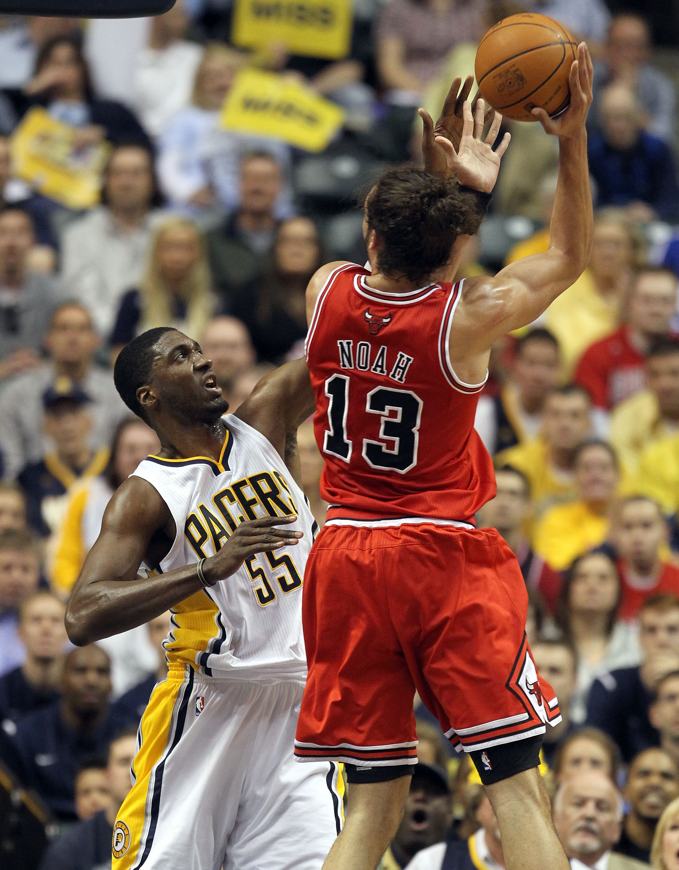 INDIANAPOLIS, IN - APRIL 21:  Roy Hibbert #55 of the Indiana Pacers defends the shot by Joakim Noah #13 of the Chicago Bulls in Game three of the Eastern Conference Quarterfinals in the 2011 NBA Playoffs on April 21, 2011  at Conseco Fieldhouse in Indiana