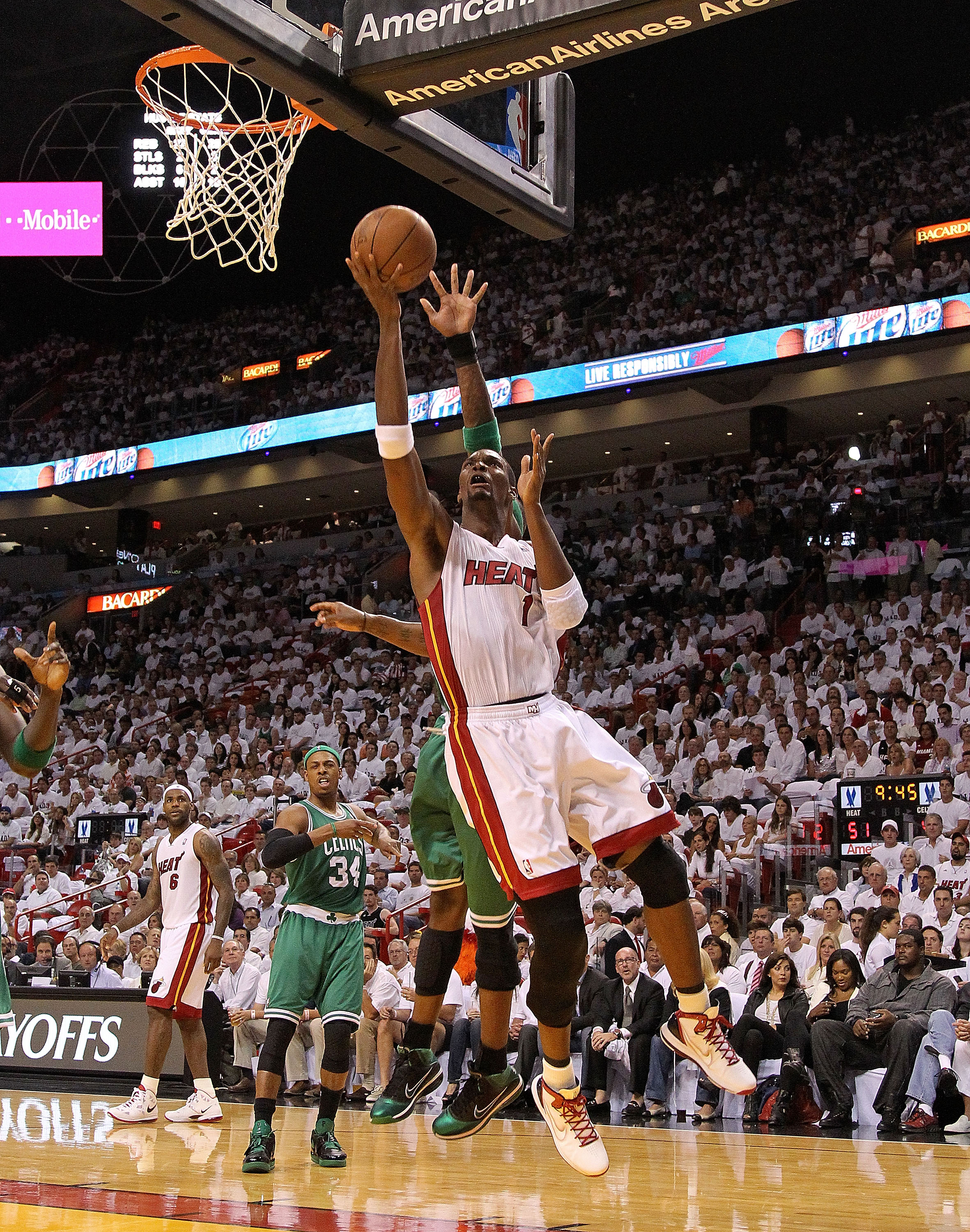 MIAMI, FL - MAY 03: Chris Bosh #1 of the Miami Heat takes a shot during Game Two of the Eastern Conference Semifinals of the 2011 NBA Playoffs against the Boston Celtics at American Airlines Arena on May 3, 2011 in Miami, Florida. NOTE TO USER: User expre