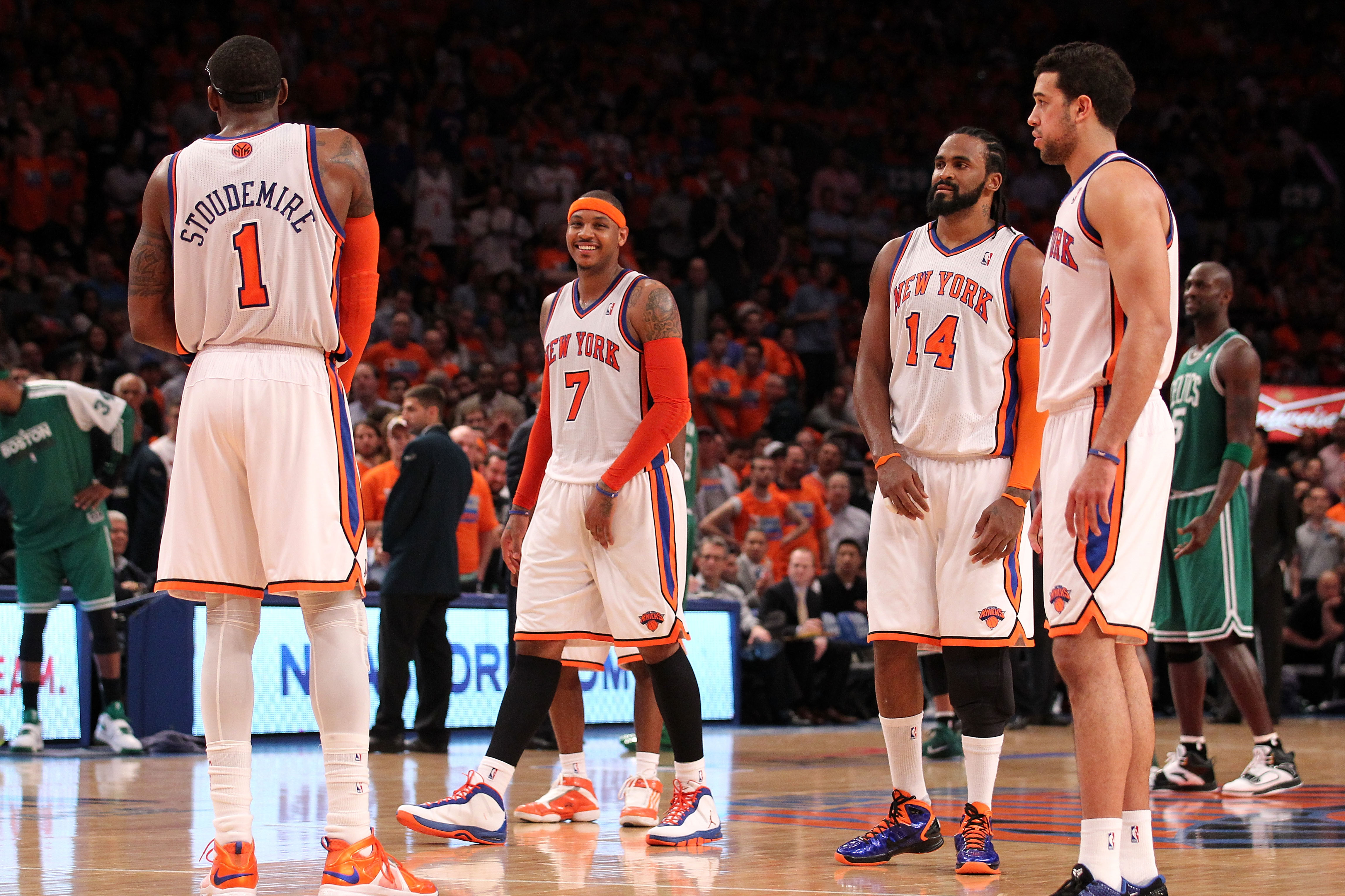 NEW YORK, NY - APRIL 24:  (L-R) Amar'e Stoudemire #1, Carmelo Anthony #7, Ronny Turiaf #14 and Landry Fields #6 of the New York Knicks look on against the Boston Celtics in Game Four of the Eastern Conference Quarterfinals during the 2011 NBA Playoffs on