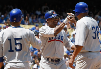 LOS ANGELES, CA - MAY 04:  (L-R) Darwin Barney #15, Marlon Byrd #24 and Carlos Zambrano #38 of the Chicago Cubs celebrate Byrd's three-run home run in the sixth inning against the Los Angeles Dodgers at Dodger Stadium on May 4, 2011 in Los Angeles, Califo