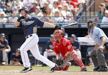 PEORIA, AZ - MARCH 15:  Ryan Ludwick #47 of the San Diego Padres hits a 2 run home run against the Los Angeles Angels of Anaheim during the third inning of the spring training game at Peoria Stadium on March 15, 2011 in Peoria, Arizona.  (Photo by Christi