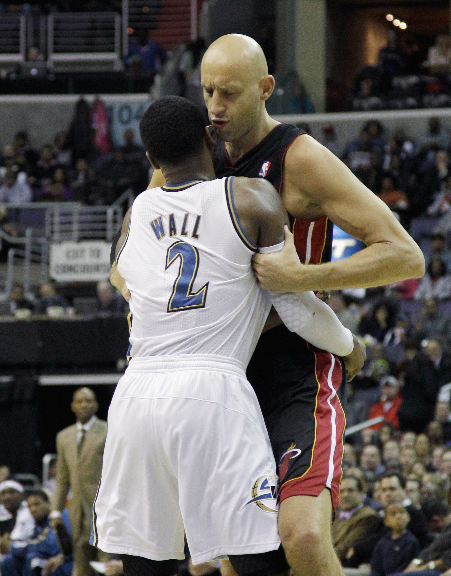 WASHINGTON, DC - MARCH 30:  John Wall #2 of the Washington Wizards and Zydrunas Ilgauskas #11 of the Miami Heat exchange words at the Verizon Center on March 30, 2011 in Washington, DC. NOTE TO USER: User expressly acknowledges and agrees that, by downloa