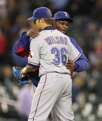 SEATTLE - MAY 04:  Starting pitcher C.J. Wilson #36 of the Texas Rangers gets a hug from manager Ron Washington #38 after throwing a complete game to defeat the Seattle Mariners 5-2 at Safeco Field on May 4, 2011 in Seattle, Washington. (Photo by Otto Gre