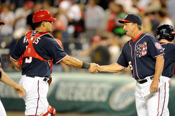 WASHINGTON, DC - MAY 02:  Wilson Ramos #3 of the Washington Nationals celebrates with manager Jim Riggleman #5 after a 2-0 victory against the San Francisco Giants at Nationals Park on May 2, 2011 in Washington, DC.  (Photo by Greg Fiume/Getty Images)