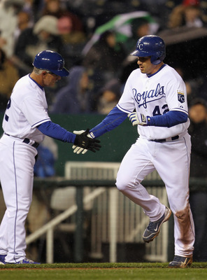 KANSAS CITY, MO - APRIL 15:  Jeff Francoeur #42 of the Kansas City Royals rounds the bases and is congratulated by third base coach Eddie Rodriguez #42 after hitting a home run during the game against the Seattle Mariners at Kauffman Stadium on April 15,