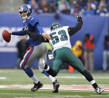 EAST RUTHERFORD, NJ - DECEMBER 19:  Eli Manning #10 of the New York Giants is sacked by Moise Fokou #53 of the Philadelphia Eagles during their game on December 19, 2010 at The New Meadowlands Stadium in East Rutherford, New Jersey.  (Photo by Al Bello/Ge