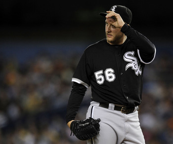 NEW YORK - SEPTEMBER 15: Mark Buehrle #56 of the Chicago White Sox reacts in the second inning against  the New York Yankees on September 15, 2008 at Yankee Stadium in the Bronx borough of New York City.  (Photo by Jeff Zelevansky/Getty Images)