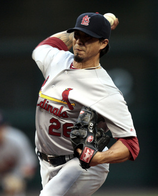HOUSTON - APRIL 27:  Pitcher Kyle Lohse #26 of the St. Louis Cardinals throws in the first inning against the Houston Astros at Minute Maid Park on April 27, 2011 in Houston, Texas.  (Photo by Bob Levey/Getty Images)