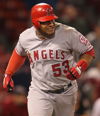 BOSTON, MA - MAY 4: Bobby Abreu #53 of the Los Angeles Angels of Anaheim hits a two-run single in the 11th inning against the Boston Red Sox at Fenway Park on May 4, 2011 in Boston, Massachusetts. The Angels won 5-3. (Photo by Jim Rogash/Getty Images)