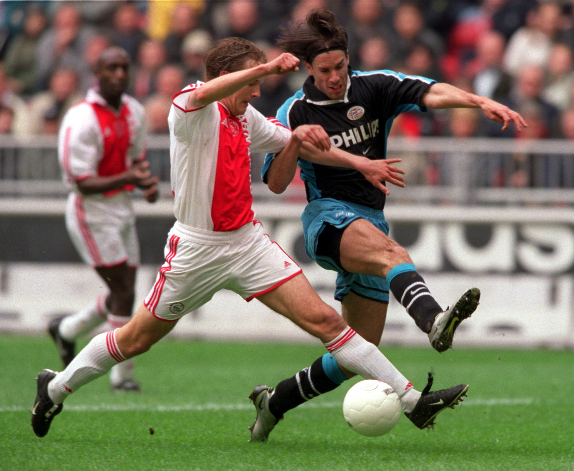 8 April 2001.  Ruud Van Nistelrooy of PSV Eindhoven tussles with Petri Pasanen of Ajax, during the league  match between Ajax and PSV at the Amsterdam Arena, the Netherlands. Mandatory Credit: Craig Prentis/ALLSPORT