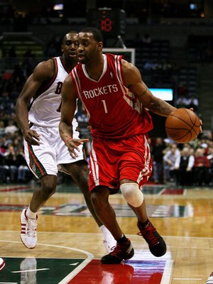 MILWAUKEE - FEBRUARY 09: Tracy McGrady #1 of the Houston Rockets drives past Luc Richard Mbah a Moute #12 of the Milwaukee Bucks on February 9, 2009 at the Bradley Center in Milwaukee, Wisconsin. The Bucks defeated the Rockets 124-112. NOTE TO USER: User