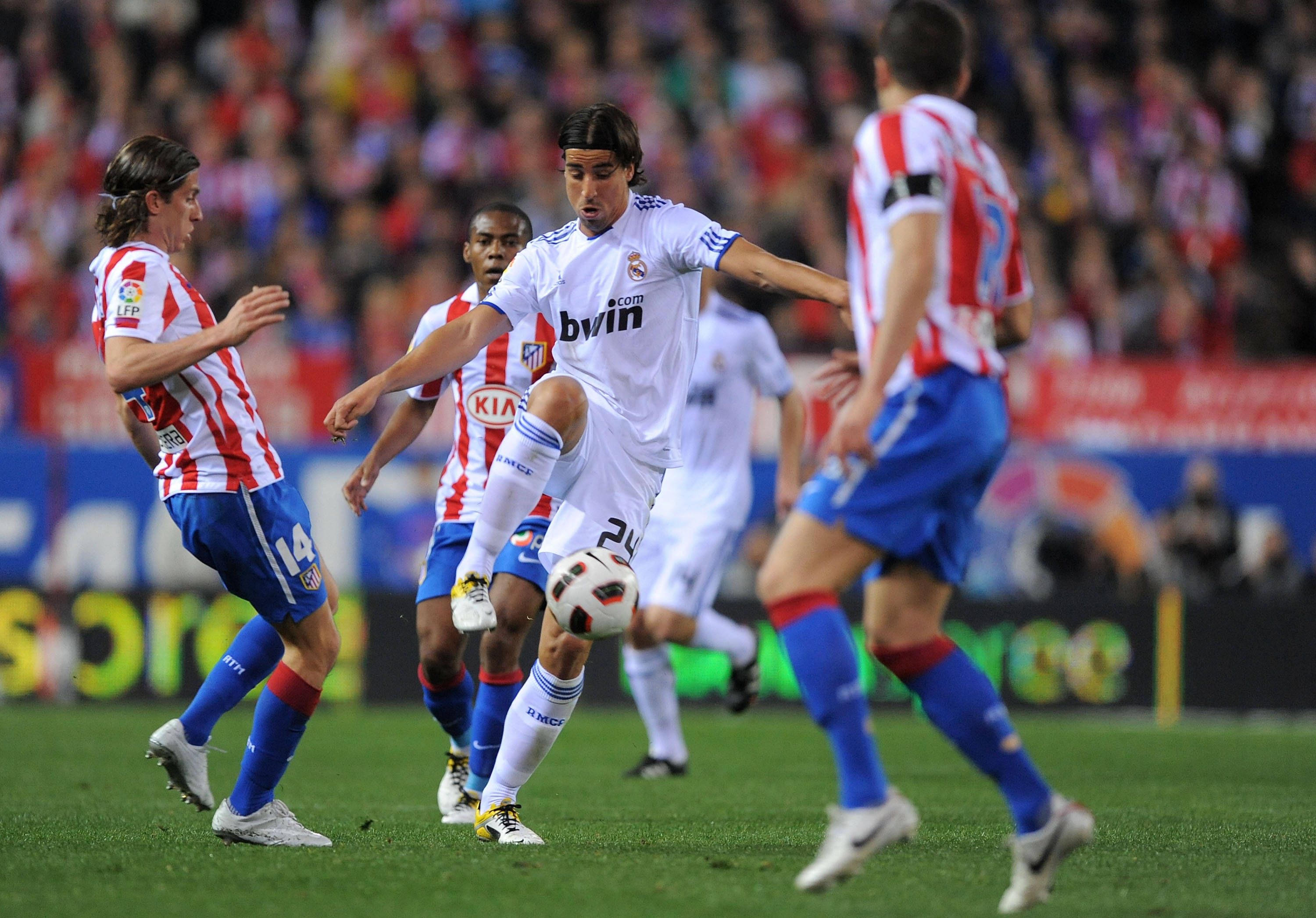 MADRID, SPAIN - MARCH 19:  Sami Khedira #24 of Real Madrid clashes with Filipe Luis of Atletico Madrid during the La Liga match between Atletico Madrid and Real Madrid at Vicente Calderon Stadium on March 19, 2011 in Madrid, Spain.  (Photo by Denis Doyle/