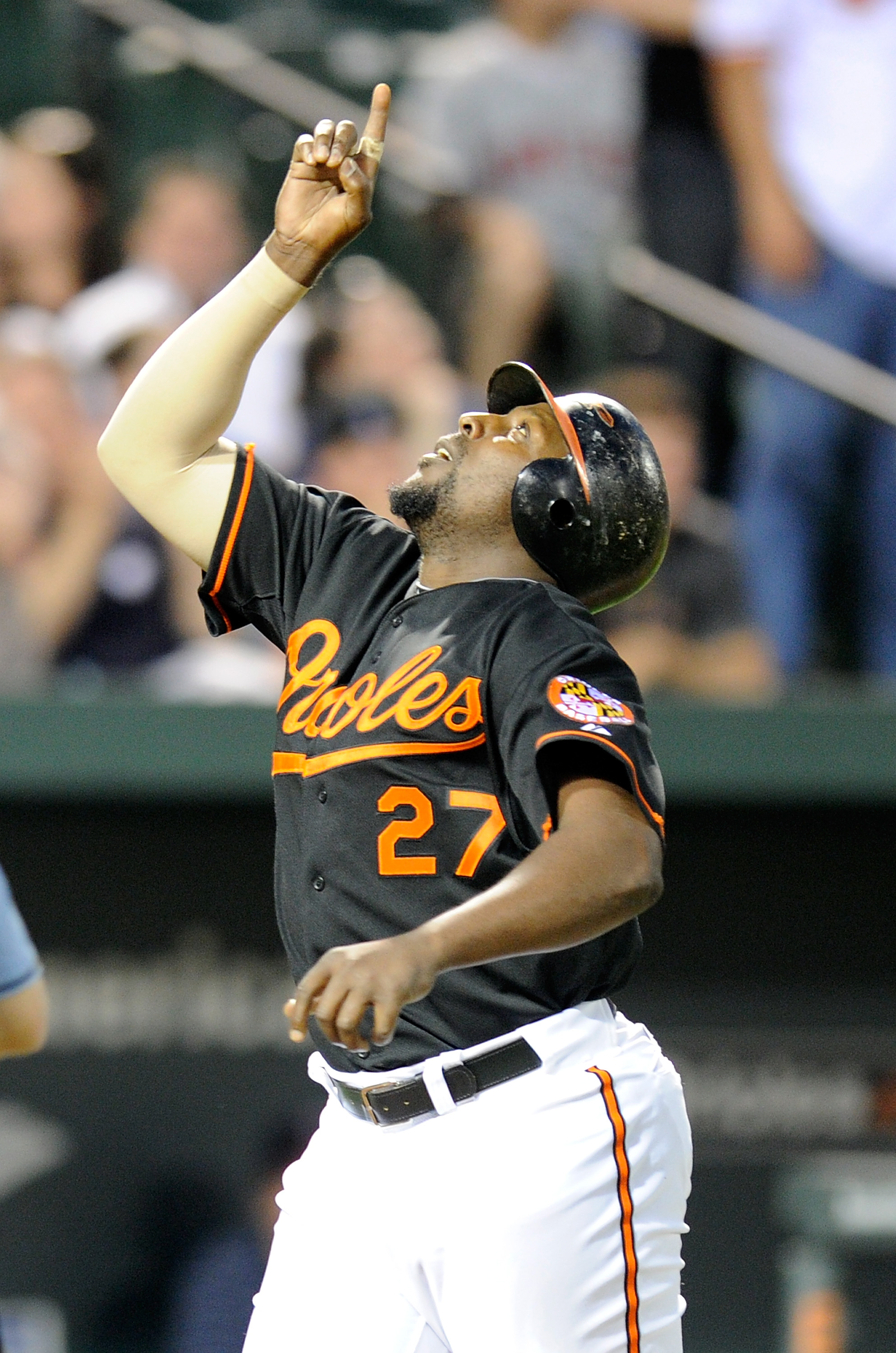 BALTIMORE, MD - APRIL 20:  Vladimir Guerrero #27 of the Baltimore Orioles celebrates after hitting a home run in the third inning against the Minnesota Twins at Oriole Park at Camden Yards on April 20, 2011 in Baltimore, Maryland.  (Photo by Greg Fiume/Ge