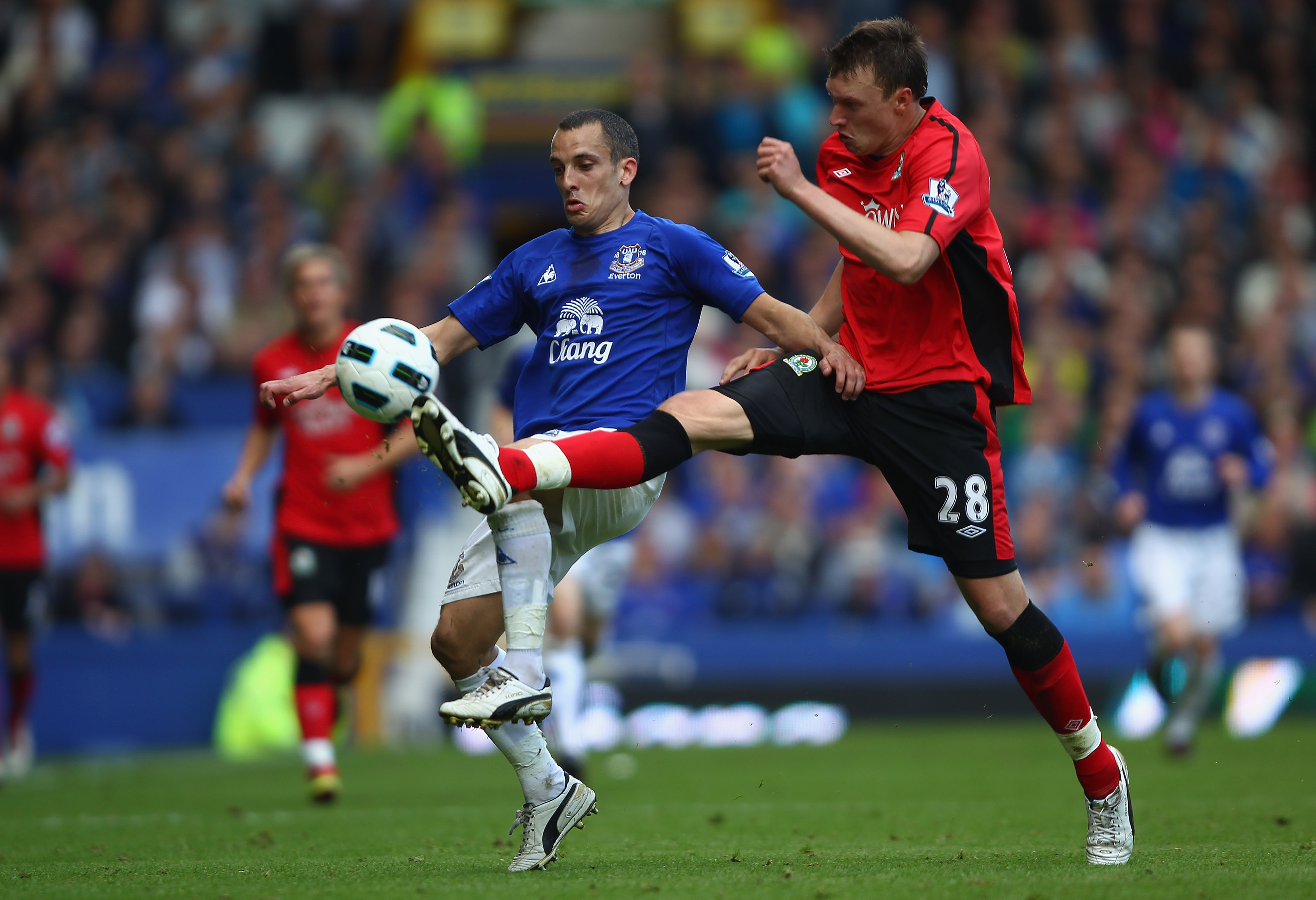 LIVERPOOL, ENGLAND - APRIL 16:  Leon Osman of Everton in action with Phil Jones of Blackburn Rovers during the Barclays Premier League match between Everton and Blackburn Rovers at  Goodison Park on April 16, 2011 in Liverpool, England.  (Photo by Clive B