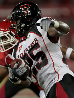 HOUSTON - SEPTEMBER 26:  Running back Baron Batch #25 of the Texas Tech Red Raiders rushes against the Houston Cougars at Robertson Stadium on September 26, 2009 in Houston, Texas.  (Photo by Thomas B. Shea/Getty Images)