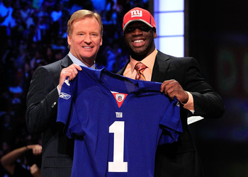 NEW YORK, NY - APRIL 28:  NFL Commissioner Roger Goodell (L) poses for a photo with Prince Amukamara, #19 overall pick by the New York Giants, on stage during the 2011 NFL Draft at Radio City Music Hall on April 28, 2011 in New York City.  (Photo by Chris