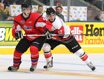 TORONTO, CAN - JANUARY 19:  Duncan Siemens #5 of Team Cherry skates in front of Boone Jenner #12 of Team Orr in the 2011 Home Hardware Top Prospects game on January 19, 2011 at the Air Canada Centre in Toronto, Canada. Team Orr defeated Team Cherry 7-1. (