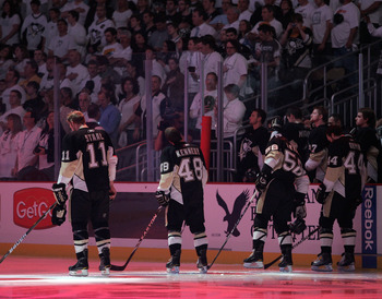 PITTSBURGH, PA - APRIL 27:  The Pittsburgh Penguins stand during the National Anthem before the start of play against the Tampa Bay Lightning in Game Seven of the Eastern Conference Quarterfinals during the 2011 NHL Stanley Cup Playoffs at Consol Energy C