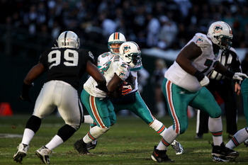 Lamarr Houston sizes up Ronnie Brown as a nice, light snack