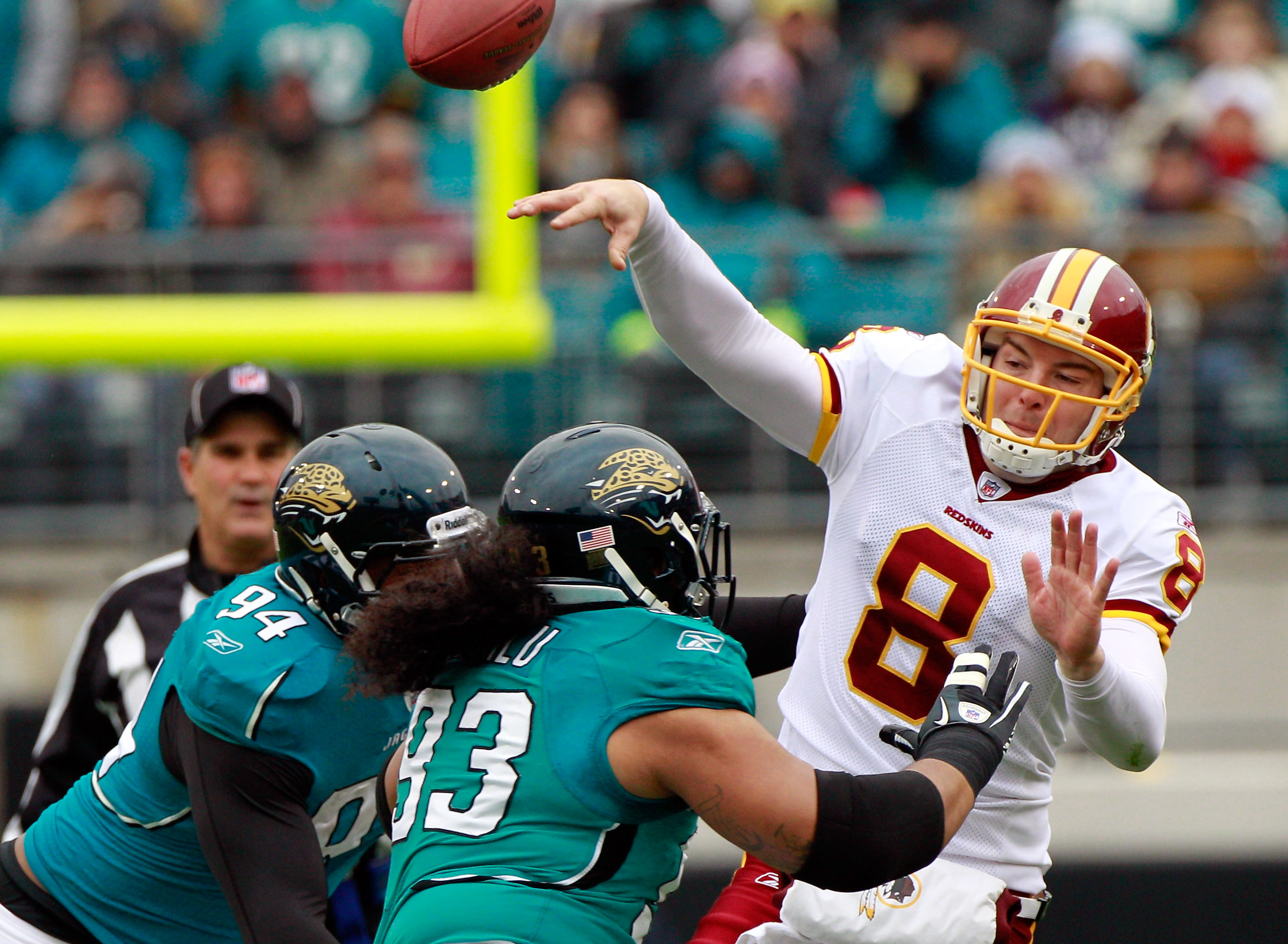 JACKSONVILLE, FL - DECEMBER 26: Quarterback Rex Grossman #8 of the Washington Redskins is pressured by Tyson Alualu #93 and Jeremy Mincey #94 of the Jacksonville Jaguars during the game at EverBank Field on December 26, 2010 in Jacksonville, Florida.  (Ph