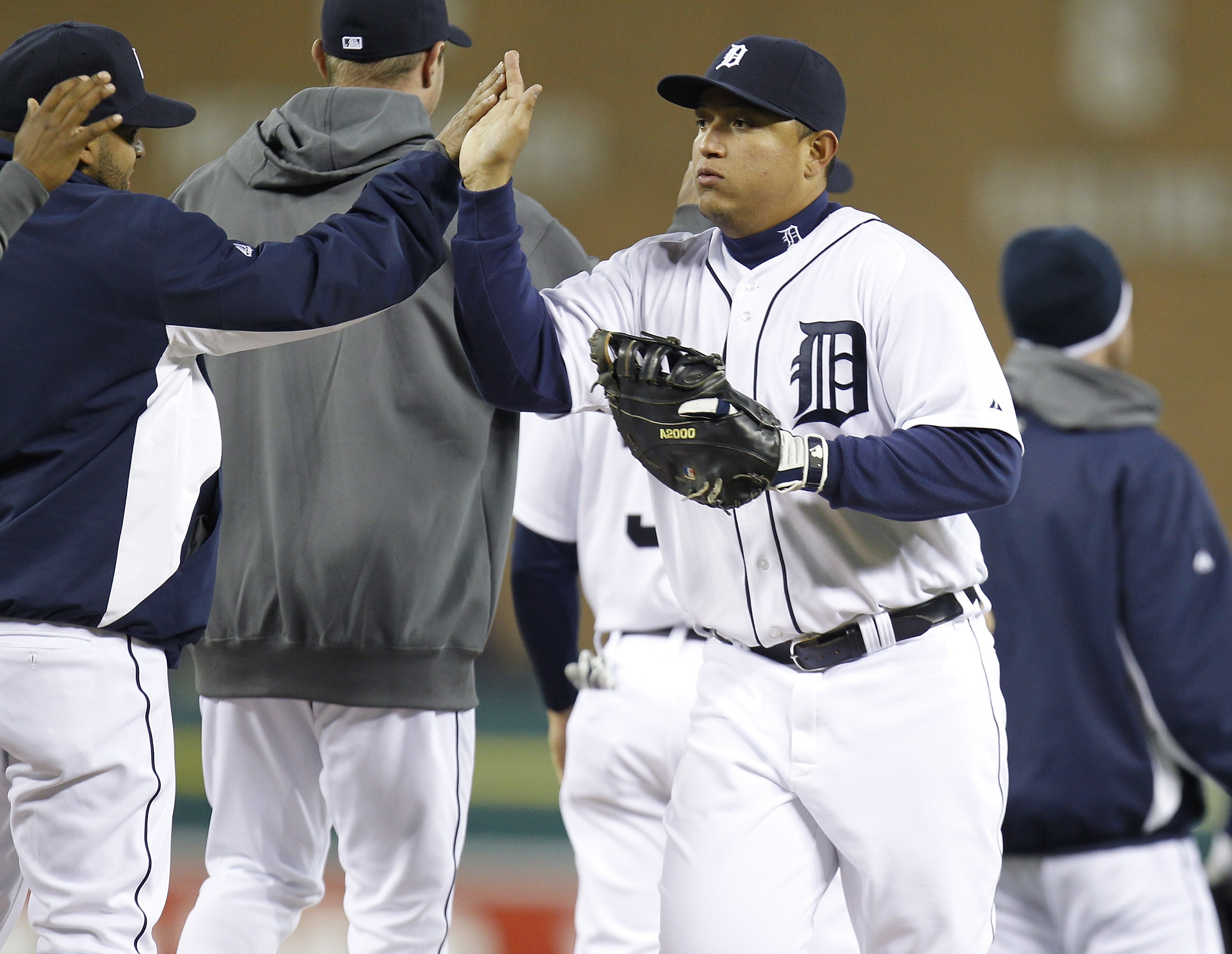 DETROIT, MI - MAY 03: Miguel Cabrera #24 of the Detroit Tigers celebrates a 4-2 victory over the New York Yankees with teammates at Comerica Park on May 3, 2011 in Detroit, Michigan. (Photo by Gregory Shamus/Getty Images)