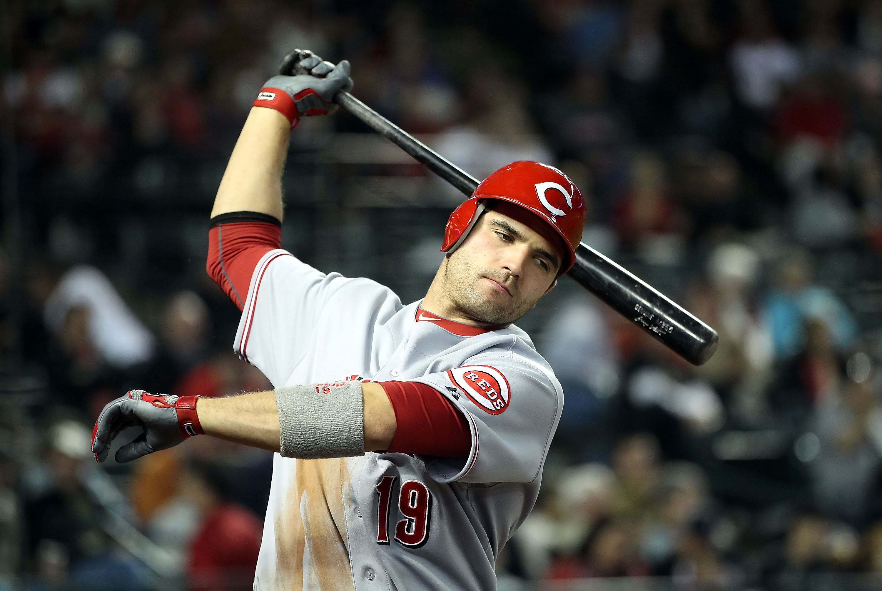 PHOENIX, AZ - APRIL 09:  Joey Votto #19 of the Cincinnati Reds warms up on deck during the Major League Baseball game against the Arizona Diamondbacks at Chase Field on April 9, 2011 in Phoenix, Arizona.  (Photo by Christian Petersen/Getty Images)