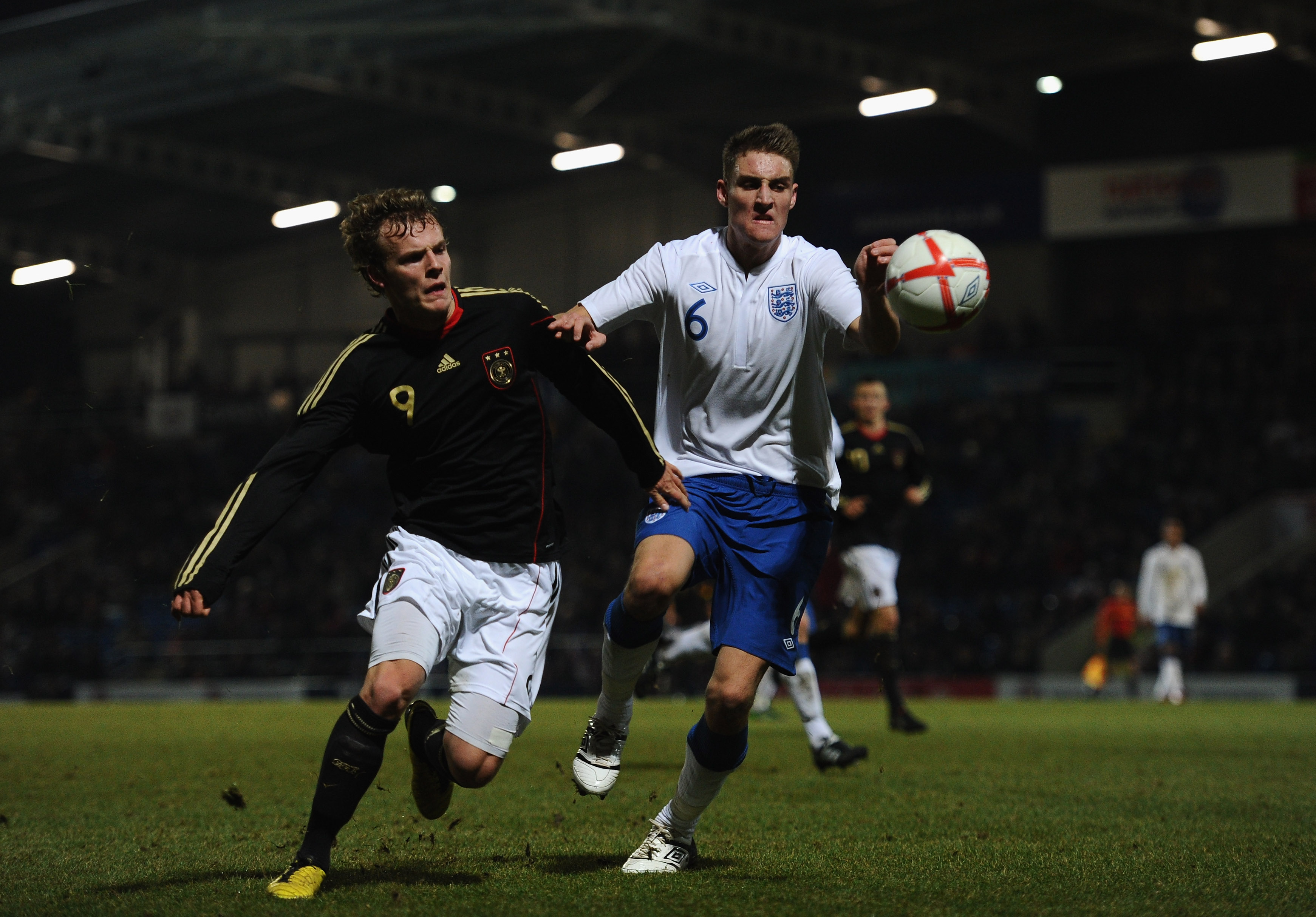 CHESTERFIELD, ENGLAND - FEBRUARY 08:  Lennart Thy of Germany battles with George Taft of England during the International Friendly match between England U19 and Germany U19 at the B2NET Stadium on February 8, 2011 in Chesterfield, England.  (Photo by Laur