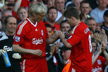 LIVERPOOL, ENGLAND - MAY 24:  Sami Hyypia of Liverpool replaces Steven Gerrard and is given the captain's armband during his last game for Liverpool in the Barclays  Premier League match between Liverpool and Tottenham Hotspur at Anfield on May 24, 2009 i