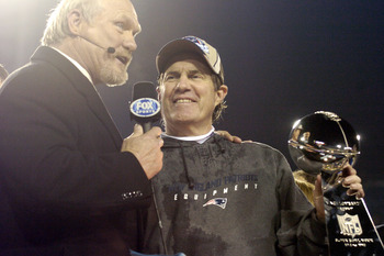 New England Patriots Head Coach Bill Belichick holds The Vince Lombardi Trophy after the Patriots won Super Bowl XXXIX at Alltel Stadium in Jacksonville, Florida on February 6, 2005.  (Photo by Al Messerschmidt/Getty Images)